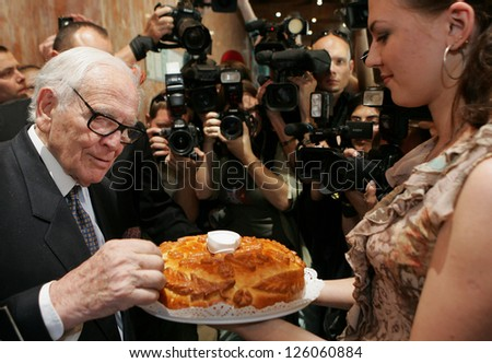 MOSCOW - JUNE 7: French designer Pierre Cardin is tasting hospitality bread and salt  on his visit to the Moscow State University of Design and Technology June 7, 2011 in Moscow, Russia.