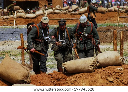 MOSCOW - JUNE 07, 2014: Historical reenactment of Osovets battle held in 1914-1915, one of the key battles of First World War. Times and Ages International Historical Festival in Kolomenskoye, Moscow. - stock photo