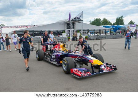 MOSCOW - JUNE 23: Mechanics prepare Formula 1 Red Bull Infiniti racing car for race at World Series by Renault in Moscow Raceway on June 23, 2013 in Moscow - stock photo