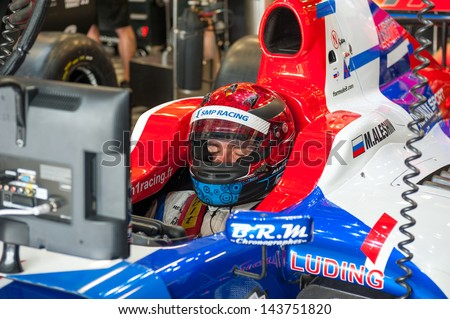 MOSCOW - JUNE 23: Mikhail Aleshin of Tech 1 R (FRA) ready for start at World Series by Renault in Moscow Raceway on June 23, 2013 in Moscow - stock photo