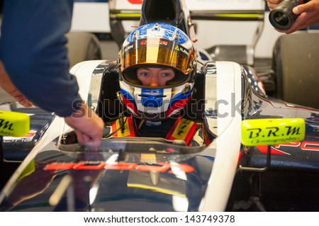 MOSCOW - JUNE 23: Nikolay Martsenko of Pons R Team (ESP) ready for start at World Series by Renault in Moscow Raceway on June 23, 2013 in Moscow - stock photo