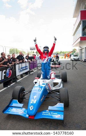MOSCOW - JUNE 23: Oliver Rowland of Manor MP Motorsport team (NED) finish first at Formula Renault 2.0 race at World Series by Renault in Moscow Raceway on June 23, 2013 in Moscow - stock photo