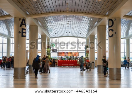 MOSCOW - JUNE 11, 2016: People and the Coffeshop counter in international terminal of Moscow Domodedovo Airport, Russia.