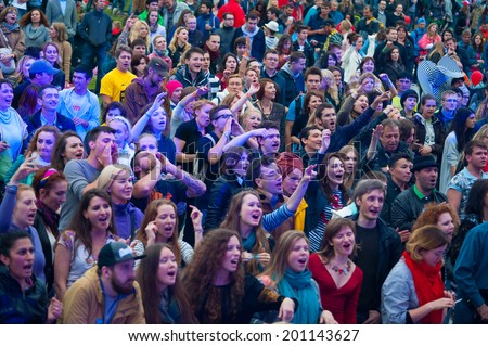 "MOSCOW - JUNE 15: People cheering at open-air concert on XI International Jazz Festival ""Usadba Jazz"" in Archangelskoye Museum-Mansion on June 15, 2014 in Moscow"
