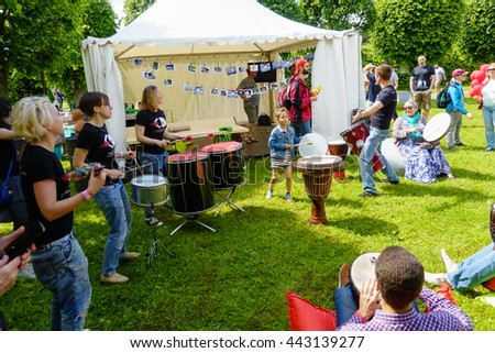 "MOSCOW - JUNE 4: People drumming on International Jazz Festival ""Usadba Jazz"" in Archangelskoye Museum-Mansion on June 4, 2016 in Moscow"