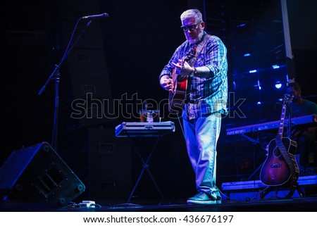 MOSCOW - 5 JUNE,2016 : Rapper Everlast (House of Pain) sing live on stage and play guitar in night club.Acoustic concert of famous rap,hip hop singer.Blues performer playing live music show