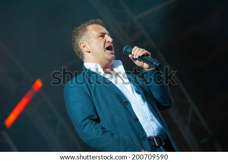 "MOSCOW - JUNE 14: Russian celebrity singer Leonid Agutin performs at XI International Jazz Festival ""Usadba Jazz"" in Archangelskoye Museum-Mansion on June 14, 2014 in Moscow"
