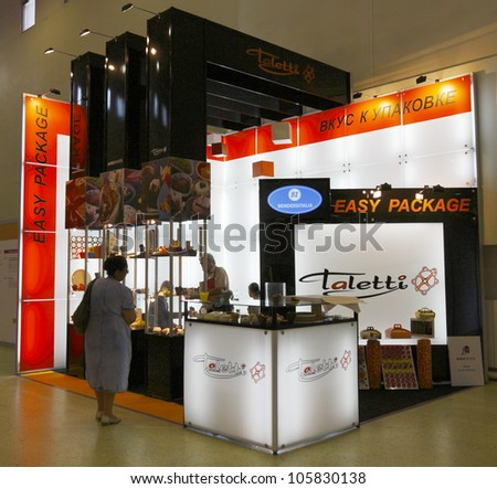 MOSCOW-JUNE 15:The stand of the Russian company TALETTI production of accessories and packaging for the food industry at the international exhibition MODERN BAKERY 2012 on June 15, 2012 in Moscow - stock photo