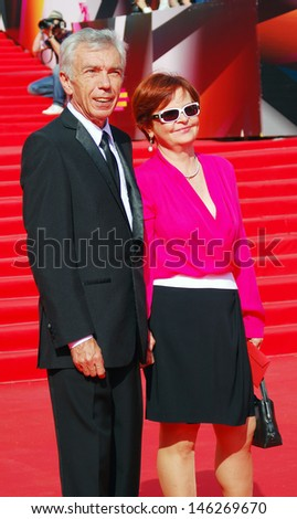 MOSCOW -  JUNE 29: Tv presenter Yuri Nikolaev with his wife at XXXV Moscow International Film Festival red carpet closing ceremony. Taken on June 29, 2013 Moscow, Russia. - stock photo