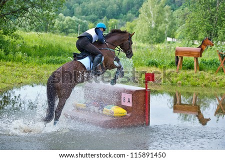MOSCOW - JUNE 02: Unidentified rider on horse is overcomes the obstacle at the International Eventing Competition CCI3*/2*/1* Russian Cup Eventing June 02, 2012 in Moscow, Russia - stock photo