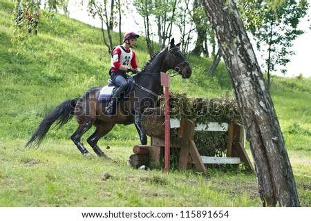 MOSCOW - JUNE 02: Unidentified rider on horse is overcomes the obstacle at the International Eventing Competition CCI3*/2*/1* Russian Cup Eventing June 02, 2012 in Moscow, Russia