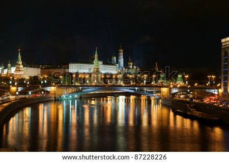 Moscow Kremlin and river under night sky - stock photo