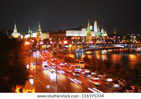 Moscow Kremlin at night. Traffic lights. Moscow river embankment.