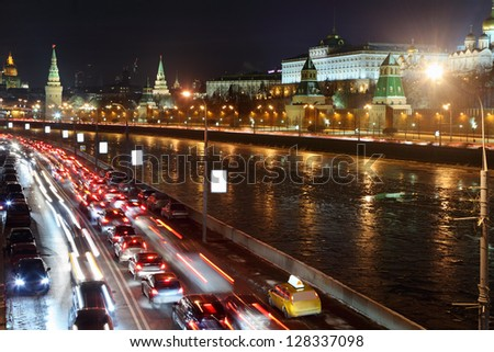 Moscow Kremlin, Moskva River and cars on road. Night cityscape.