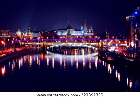 Moscow Kremlin. Night scene. The Moscow river embankment. The bridge over the river is decorated by lights in colors of Russian state flag - red, blue and white.  UNESCO World Heritage Site. - stock photo