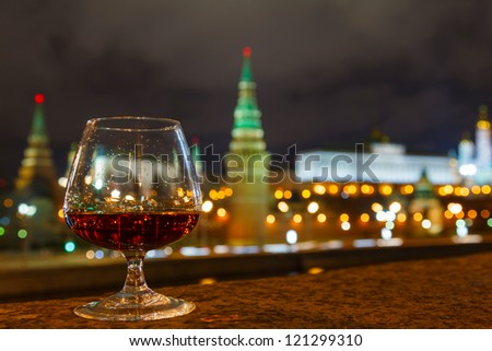 Moscow Kremlin night view from the waterfront and glass of brandy