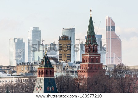 Moscow Kremlin on the modern building background, Russian Federation - stock photo