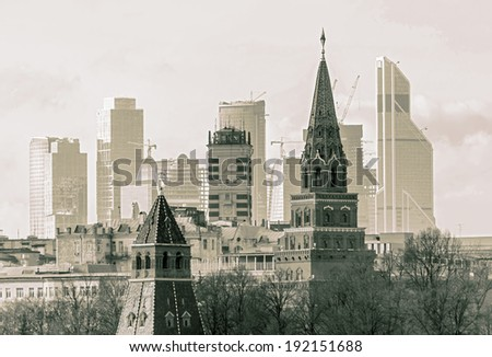 Moscow Kremlin on the modern building background, Russian Federation (stylized retro) - stock photo