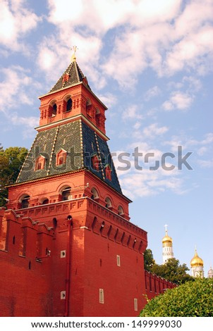 Moscow Kremlin tower and Ivan the Great Bell-Tower in summer. Blue sky with clouds background. UNESCO World Heritage Site.