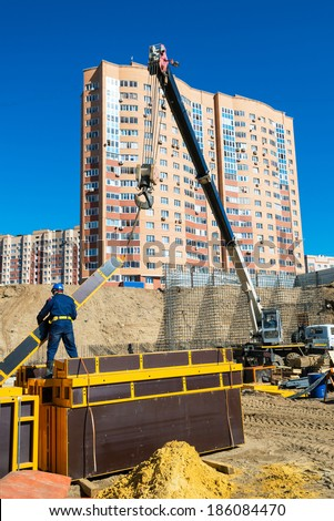 MOSCOW - MAR, 27: Construction site workers on march 27, 2014 in Moscow, Russia. Urban construction is at a faster pace in Russia. - stock photo