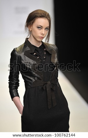 MOSCOW - MARCH 23: A Model walks runway at the Fur Garden for Fall Winter 2012 presentation during MBFW on March 23, 2012 in Moscow, Russia