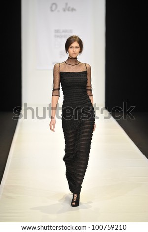 MOSCOW - MARCH 23: A Model walks runway at the O. Jen for Fall Winter 2012 presentation during MBFW on March 23, 2012 in Moscow, Russia - stock photo