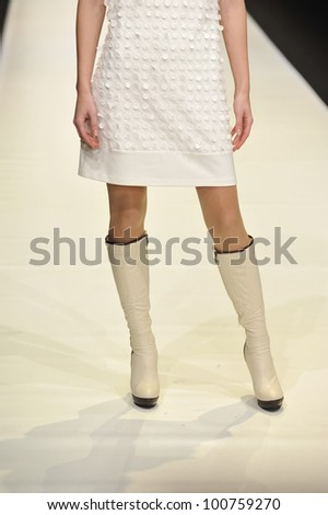 MOSCOW - MARCH 23: A Model walks runway at the O. Jen for Fall Winter 2012 presentation during MBFW on March 23, 2012 in Moscow, Russia