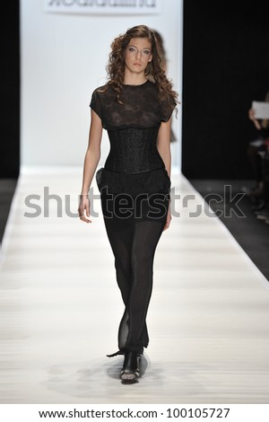 MOSCOW - MARCH 24: A Model walks runway at the Yana Gattaulina for Fall/Winter 2012 presentation during MBFW on March 24, 2012 in Moscow, Russia
