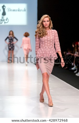 MOSCOW - MARCH 23: A model walks the runway during the demonstration of a collection of Vera Domokosh at the Moscow Fashion Week, March 23, 2016, Russia - stock photo