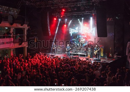 MOSCOW - MARCH 21: Black Obelisk rock band playing a concert at Red Club on March 21, 2015 in Moscow. Black Obelisk is one of the most popular rock bands in Russia. - stock photo