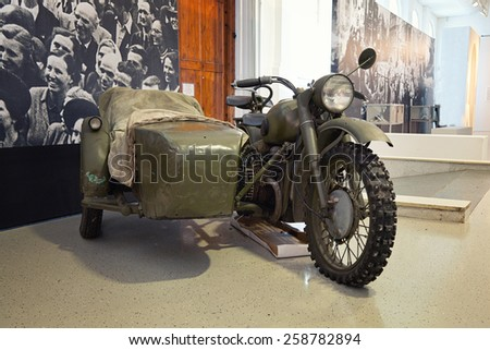 """Moscow - March 7: Moscow State Exhibition Hall """"New Manege"""", the exhibition """"Remember"""". Military motorcycle with a sidecar World War II, Russia, Moscow, March 7, 2015 - stock photo"""