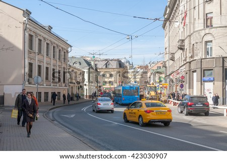 MOSCOW - MARCH 29: Pedestrians, taxi, trolleybus and cars on Solyanka street on March 29, 2016 in Moscow. Solyanka is one of the oldest streets in Moscow.