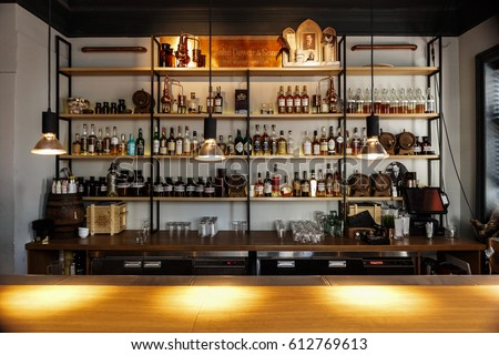MOSCOW-26 MARCH,2017: Popular bar with many alcoholic drinks.Adult night life entertainment background.Bar interior background.Indoor pub interior backdrop.Strong drinks for adults.Buy alcohol at bar.