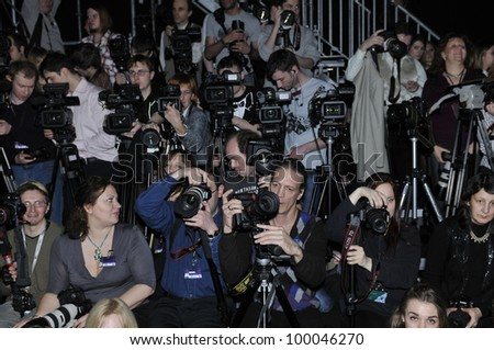 MOSCOW - MARCH 25: Press photographers at the photographers platform at YeZ by Yegor Zaitsev for Fall Winter 2012 presentation during MBFW on March 25, 2012 in Moscow, Russia