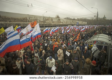 MOSCOW - March 1: Russian opposition hold mourning march after Boris Nemtsov death Moscow on March 1, 2015 in Moscow, Russia. Boris Nemtsov was shot dead on Februrary 28 2015 . - stock photo