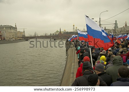 MOSCOW - March 1: Russian opposition hold mourning march after Boris Nemtsov death Moscow on March 1, 2015 in Moscow, Russia. Boris Nemtsov was shot dead on Februrary 28 2015 .
