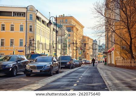 Moscow - march 18: The historical part of the city - street Pyatnitskaya. Zamoskvorechie. Traffic jam, bike path. Russia, Moscow, march 18, 2015 - stock photo