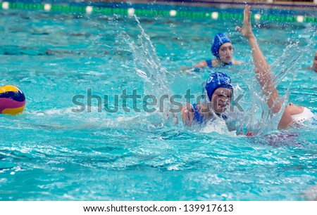 MOSCOW - MARCH 23 : Unidentified sportsmen fight on semifinal waterpolo game Skif Izmailovo vs Widex Donk Netherlands, women, on March 23, 2013. Moscow, Russia