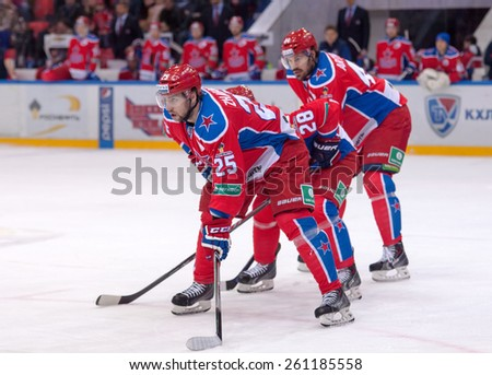 MOSCOW - MARCH 12: V. Gharkov (25) and E. Artukhin (44) on faceoff during hockey game Yokerit vs CSKA on Russia KHL championship on March 12, 2015, in Moscow, Russia. CSKA won 3:2 - stock photo