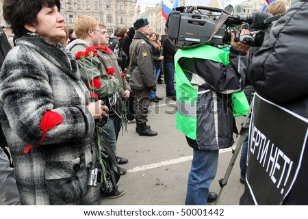"MOSCOW - MARCH 31: Youth hold flowers during ""Generation Against Terror"" anti-terror demonstration at Triumphal Square on March 31, 2010 in Moscow."