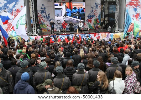 "MOSCOW - MARCH 31: Youth watch concert during ""Generation Against Terror"" anti-terror demonstration at Triumphal Square on March 31, 2010 in Moscow."
