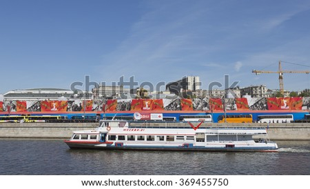 Moscow - May 7, 2015: A passenger ship Moscow-21 floats on the river against the background of Mokwa crossing the promenade and foitserov Victory Parade rehearsal on May 7th, 2015, Moscow, Russia