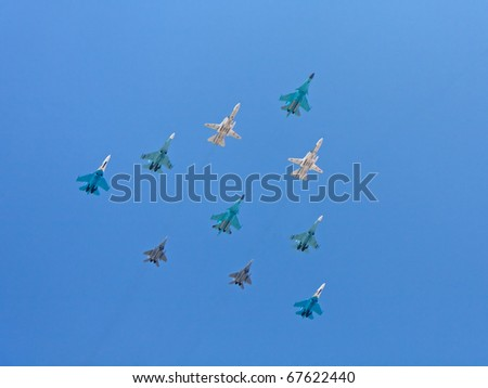 MOSCOW - MAY 9: Aerobatic demonstration on Mig-29, Su-27, Su-24 and Su-34 aircrafts on parade devoted to 65th anniversary of victory in the Great Patriotic war on May 9, 2010 in Moscow.