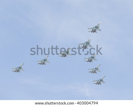 Moscow-May 9, 2015: Aerobatic team Russian Falcons eight military gray-blue Su-30 is flying high in the sky at the Victory Day parade May 9, 2015, Moscow, Russia