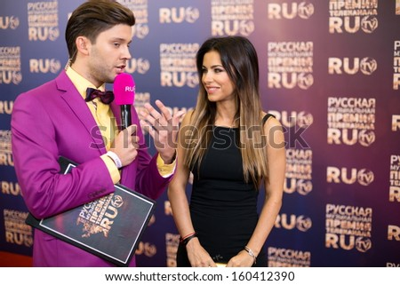 MOSCOW - MAY 25: Ani Lorak with presenter on Russian Music Award channel RUTV in Crocus City Hall on May 25, 2013 in Moscow, Russia. - stock photo