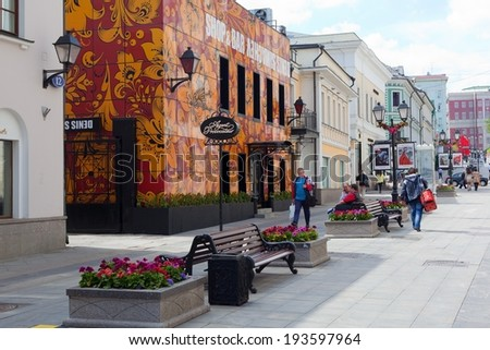 MOSCOW - MAY 12: Buildings, flower beds, benches and walking people on Stoleshnikov street on May 12, 2014 in Moscow - stock photo