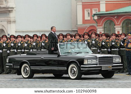 MOSCOW - MAY 09: Celebration of the 67 anniversary of the Victory Day (WWII) on Red Square on May 9, 2012 in Moscow, Russia. Russian defense minister Anatoliy Serdyukov toured the troops - stock photo