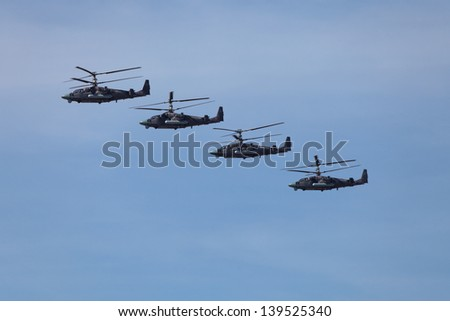 MOSCOW - MAY 09: Celebration of the 68th anniversary of the Victory Day (WWII). Flight of aircraft in the sky, a group of military helicopters Ka-52 Havoc on May 9, 2013 in Moscow, Russia