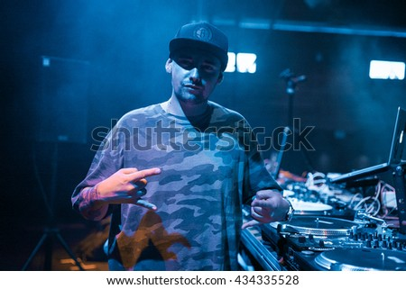 MOSCOW - 21 MAY, 2016 : DMC World DJ event at Yotaspace nightclub. Headliner was the 2002 World Champion DJ Kentaro from Japan.DJ Nik One posing on stage