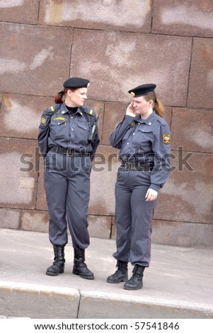 MOSCOW - MAY 29: Female police officers follow the order on the march against breast cancer on MAY 29, 2010 in Moscow, Russia - stock photo